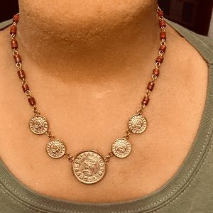Necklace with faux Mayan coins